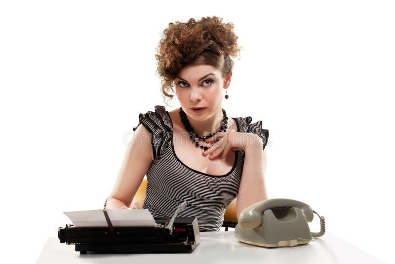 采取电话的女实业家在办公室 库存照片