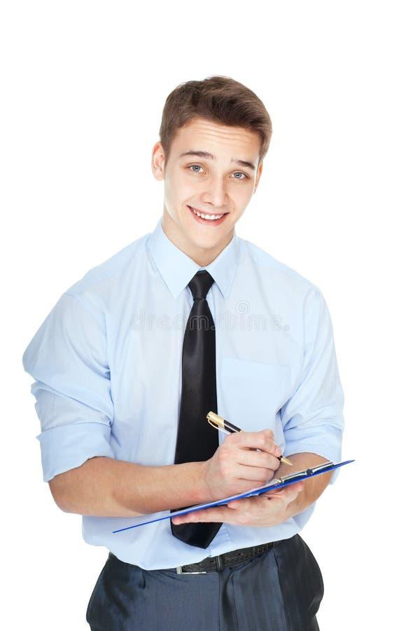 采取笔记的年轻商人隔绝在白色背景 库存图片