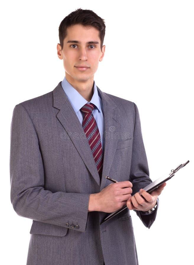 采取笔记的年轻商人画象隔绝在白色 免版税库存图片