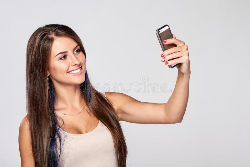 采取自画象的妇女 免版税图库摄影