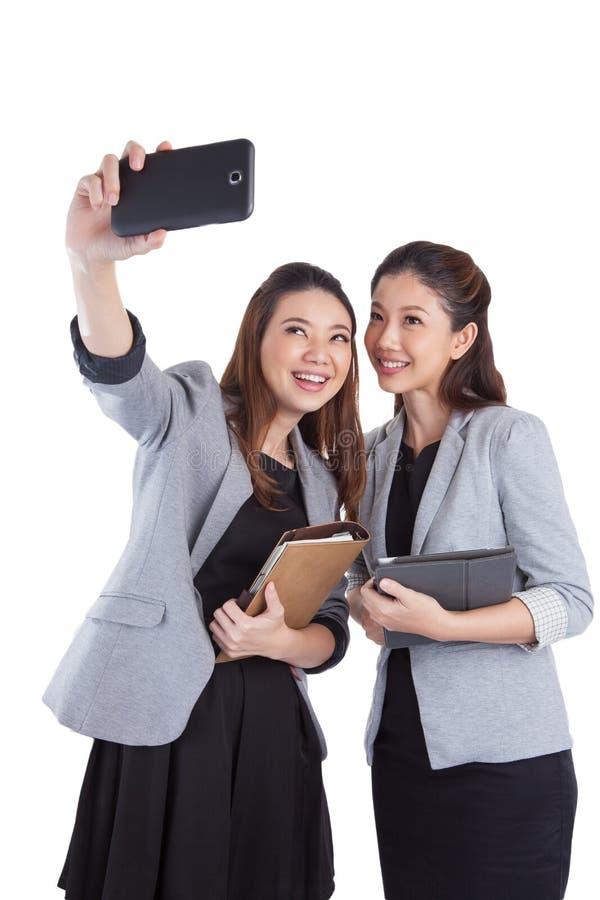 采取自画象的年轻女实业家 库存图片