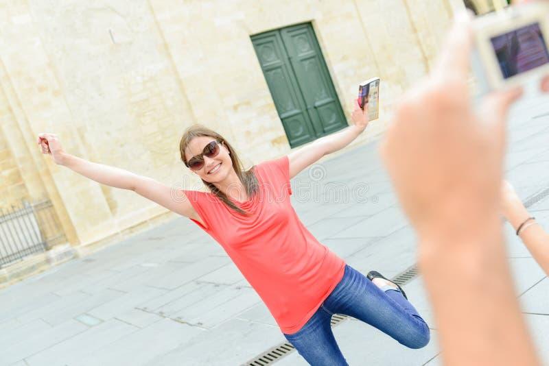 采取跳跃为喜悦的照片夫人 图库摄影