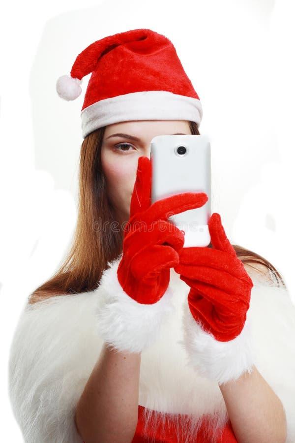 采取photgraph的圣诞老人女孩 免版税库存照片