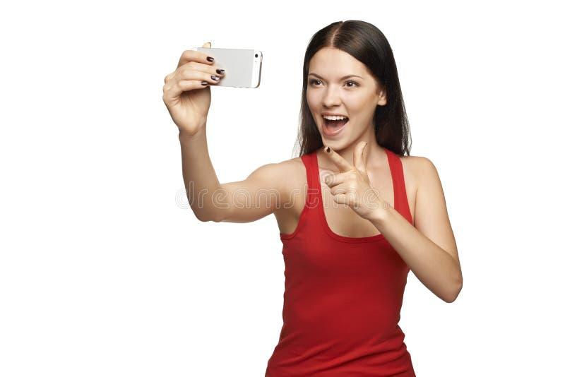 采取selfie的愉快的少妇 免版税图库摄影