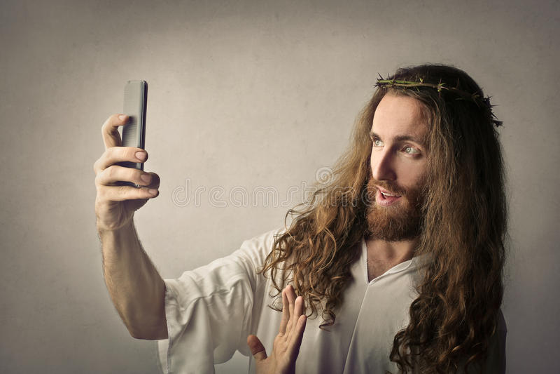 采取selfie的耶稣 库存图片