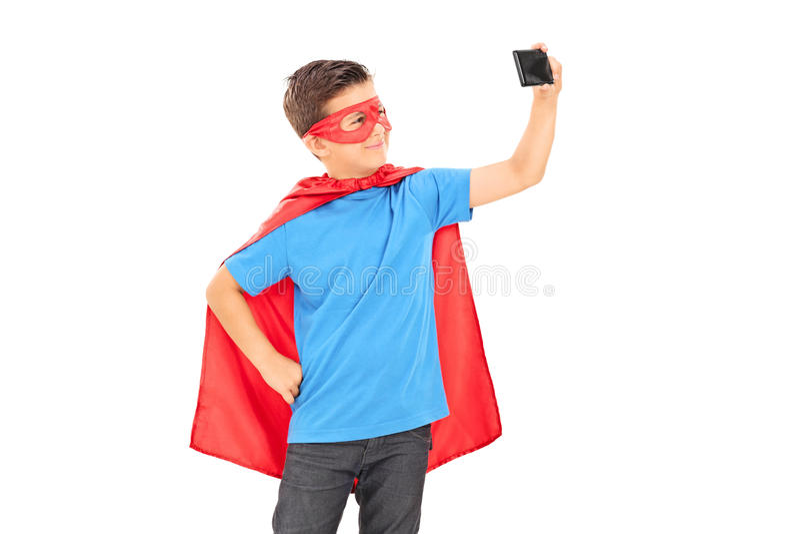 采取selfie的超级英雄服装的男孩 免版税库存照片