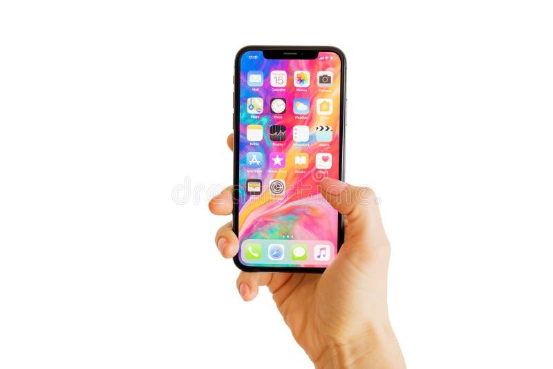 里加,拉脱维亚- 2018年3月15日:最新的一代iPhone x的家庭屏幕 库存照片