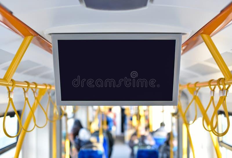 里面广告电视显示器在城市公共交通工具的 免版税库存图片