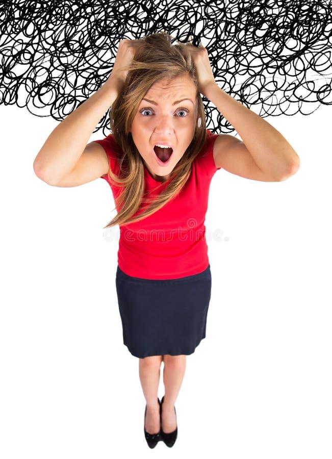 重点 亚裔企业女实业家白种人沮丧的滑稽的头发她的拉重点的图象强调妇女年轻人 库存照片