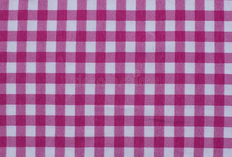 野餐桌布料桌布格子花呢披肩红色背景织品vichy方格花布面包店国家格子呢减速火箭的方形的方格的印刷品 库存照片