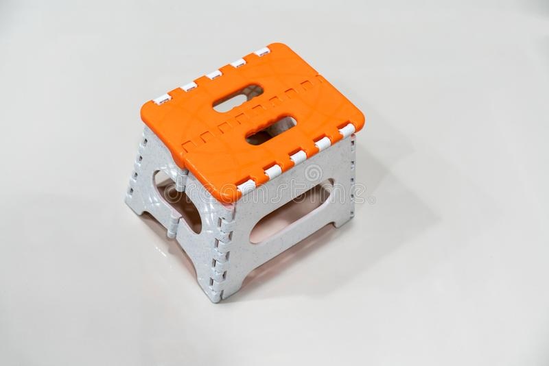 野餐的微型可折叠的塑料凳子 库存图片