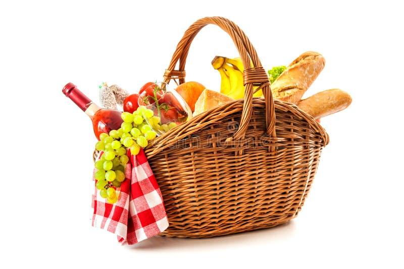 野餐篮子用果子面包和酒 图库摄影