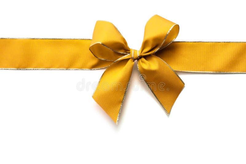 金丝带和弓 免版税库存照片