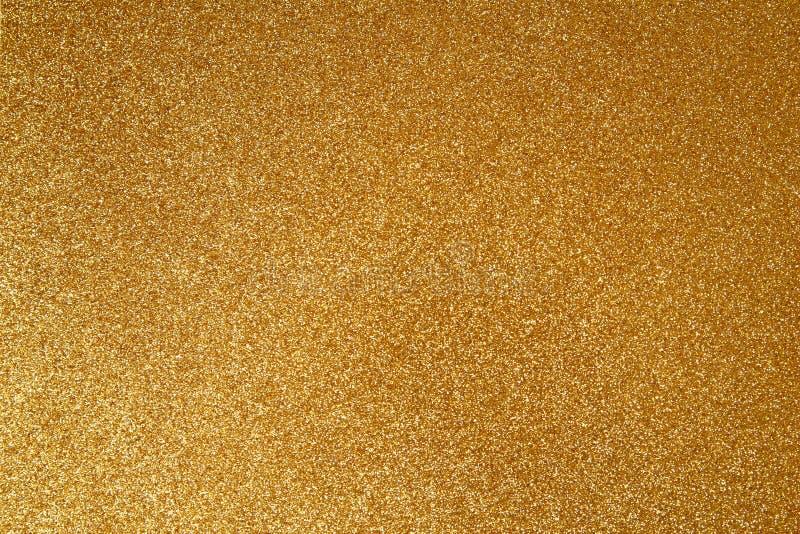 金光纹理闪光纸背景 摘要闪烁的金色闪光背景,带有波光、散焦光 图库摄影
