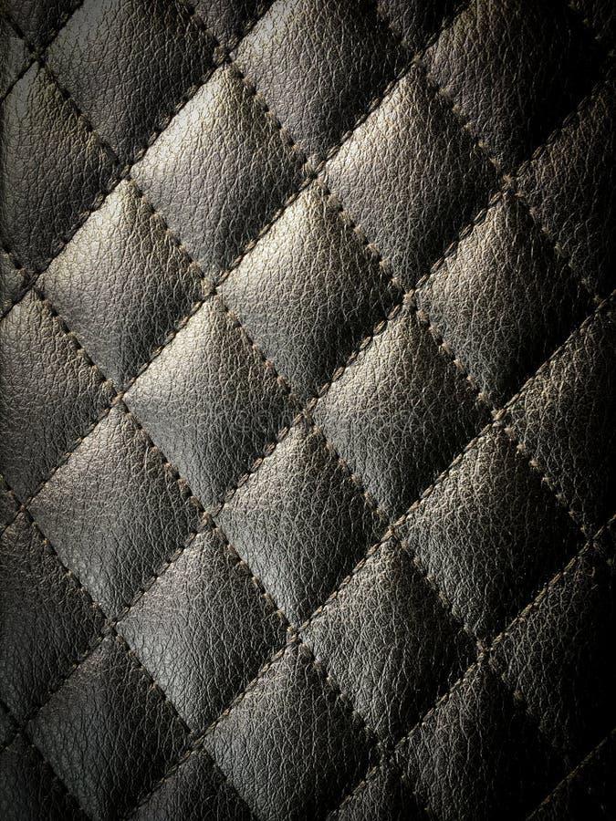 金刚石缝了皮革设计师背景 库存照片