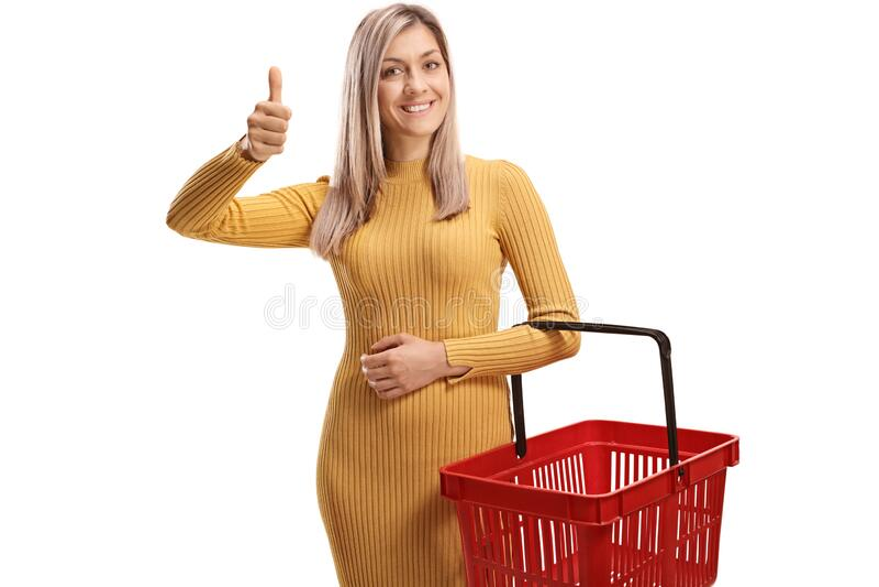 金发女子,拿着购物篮,手指竖起大拇指 库存图片