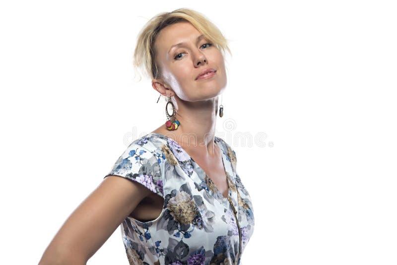金发碧眼的女人照片杂色的礼服的 图库摄影