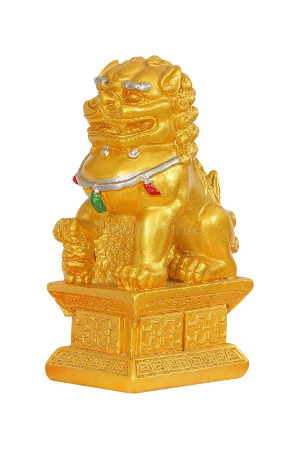 金在白色的狮子雕象 库存照片