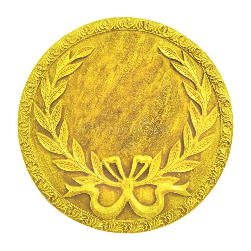 金在白色背景隔绝的回合奖牌 免版税库存图片
