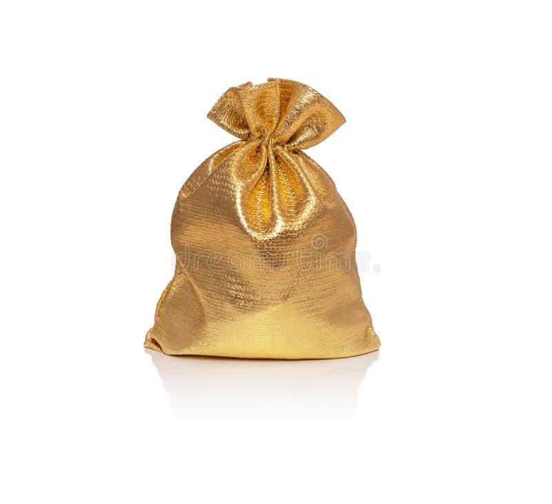 金在白色背景隔绝的礼物袋子 免版税库存照片