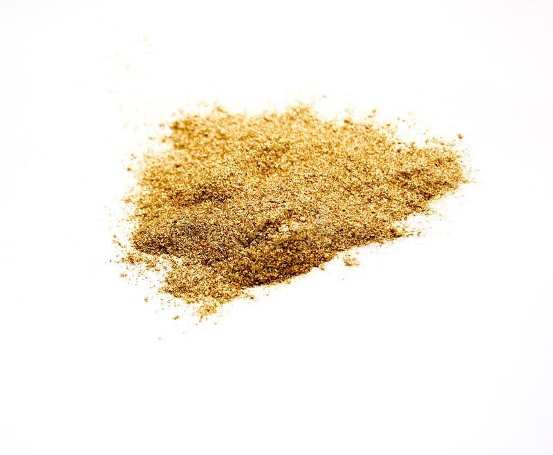 金子上色了在白色、财富和豪华概念的尘土 免版税图库摄影