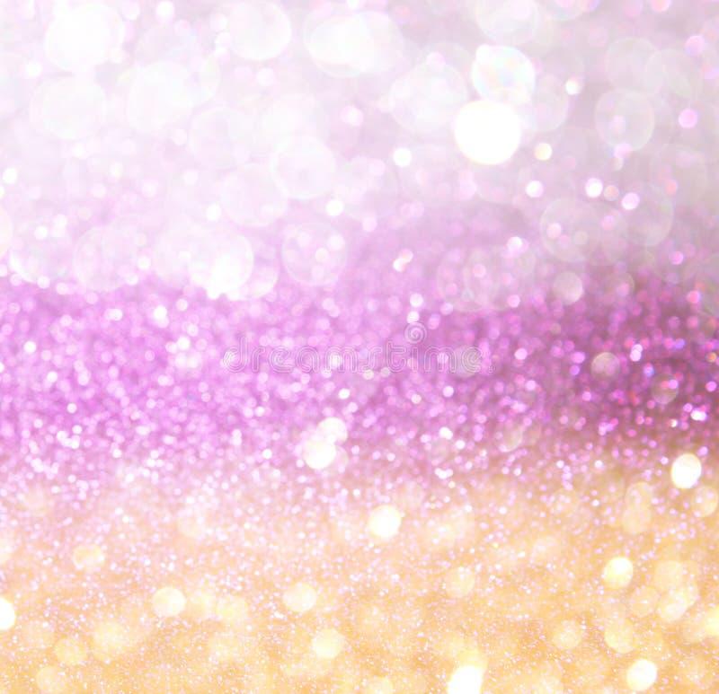 金子和桃红色抽象bokeh光。defocused背景 库存图片