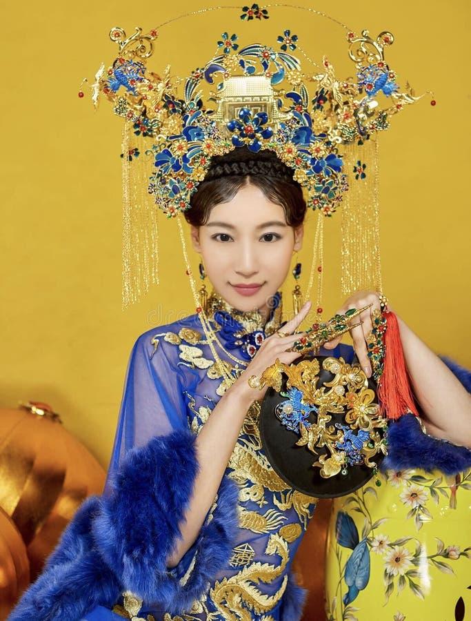 金子和蓝色古老衣裳在中国 免版税图库摄影
