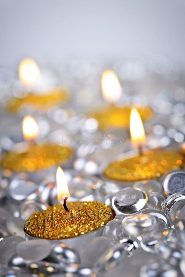 金子圣诞节蜡烛 免版税库存照片