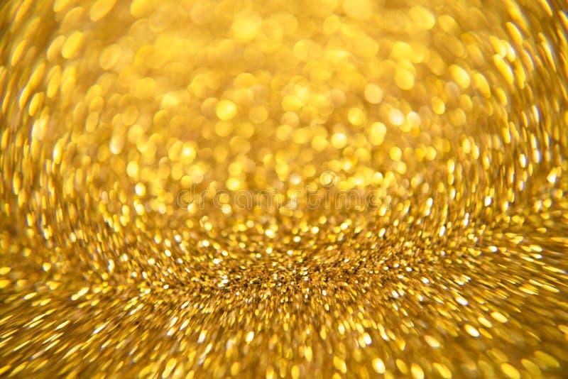 金子闪烁和抽象圣诞节bokhe背景影像 免版税库存照片