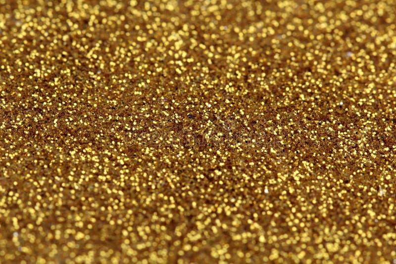 金子闪烁摘要背景 免版税库存照片