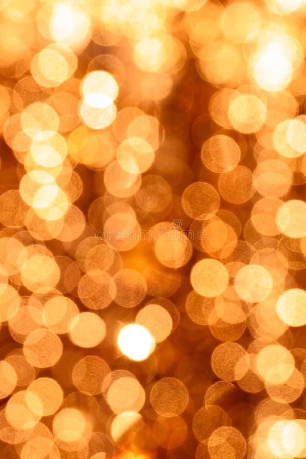 金子闪烁的圣诞灯bokeh 抽象背景弄脏了 免版税图库摄影