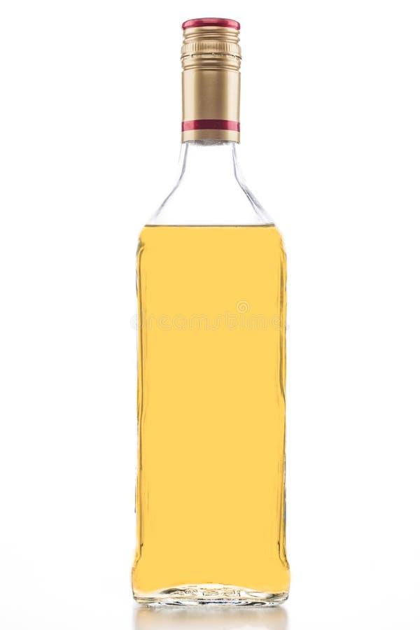 金子龙舌兰酒瓶 免版税图库摄影