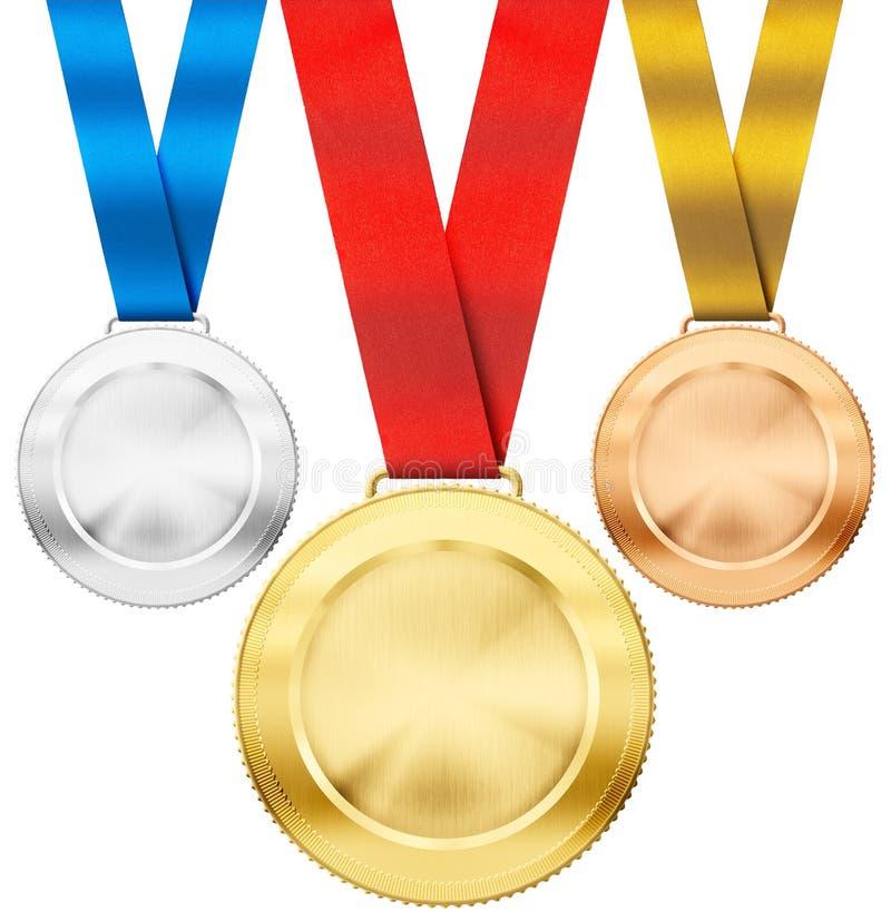 金子,银,与丝带的古铜色体育奖牌 免版税图库摄影
