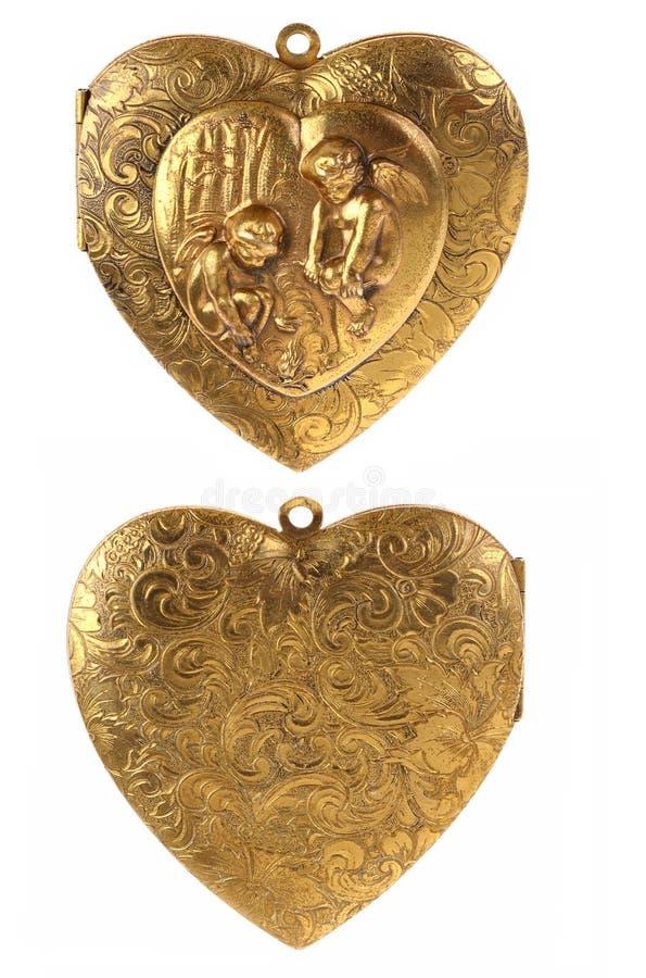 金小盒与天使的心脏魅力 免版税库存图片