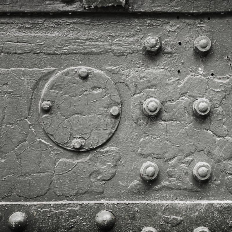 金属与螺栓和铆钉的背景纹理 免版税库存照片