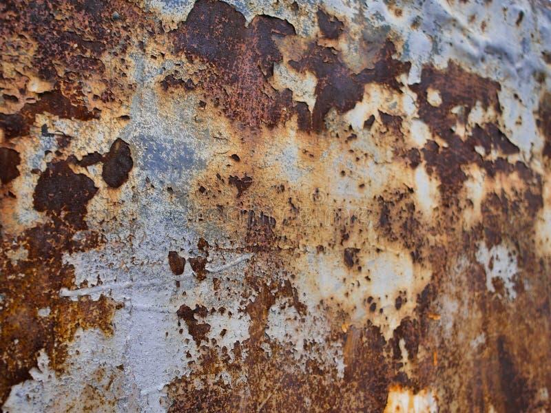 金属化铁锈纹理,抽象难看的东西背景,在左边的焦点 图库摄影
