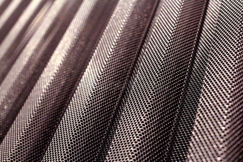 金属耐久的穿孔的涂层钢片 库存图片