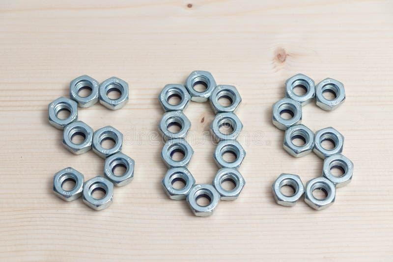 金属镀铬物螺栓螺栓sos帮助紧急标志 库存图片