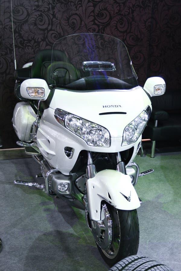 金本田摩托车白色翼 免版税库存照片