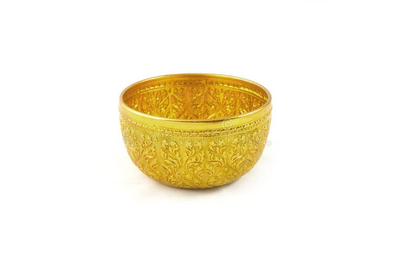 金碗和盘子有垫座的 库存图片