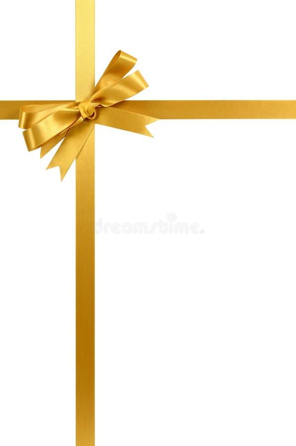 金礼物在白色背景垂直隔绝的丝带弓 免版税库存照片