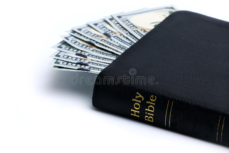 金钱和圣经 免版税库存照片