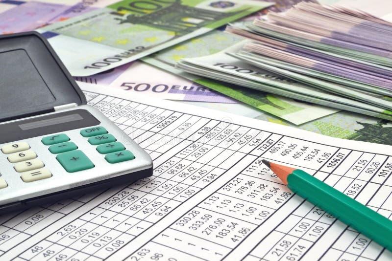 金钱和计算器 免版税库存照片