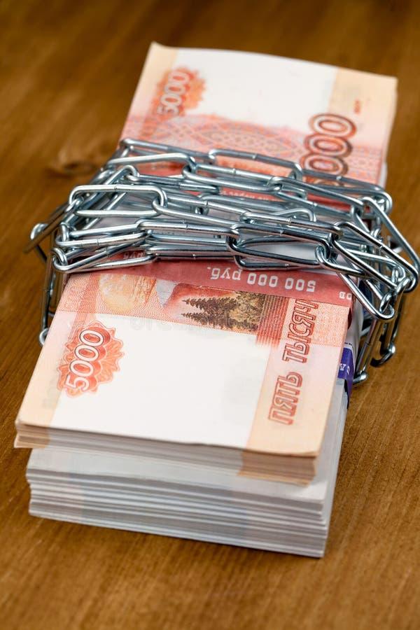 金钱和锁 免版税库存图片