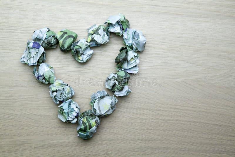 金钱心脏符号表背景没人 免版税库存图片