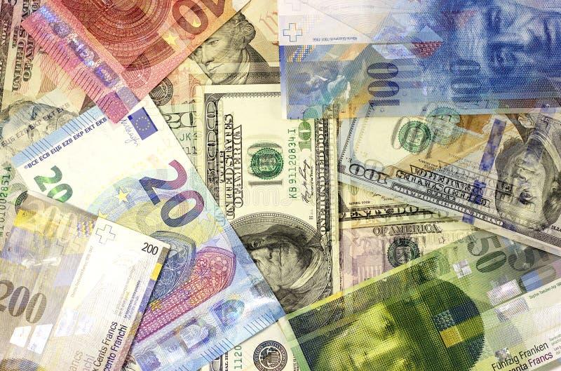 金钱背景美国美元,欧洲和瑞士法郎 库存图片