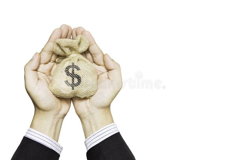 金钱袋子在手中代表储款金钱或投资买家或贷款 免版税图库摄影