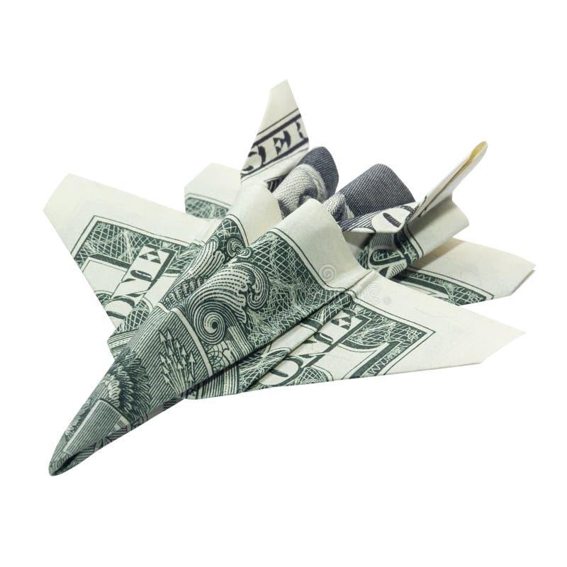 金钱Origami喷气式歼击机折叠了与真正的一在白色背景隔绝的美金 免版税图库摄影