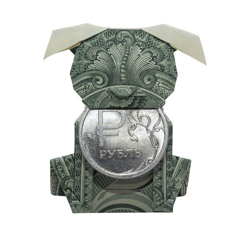金钱Origami小狗举行铸造折叠与真正的一在白色背景隔绝的美金 免版税库存图片