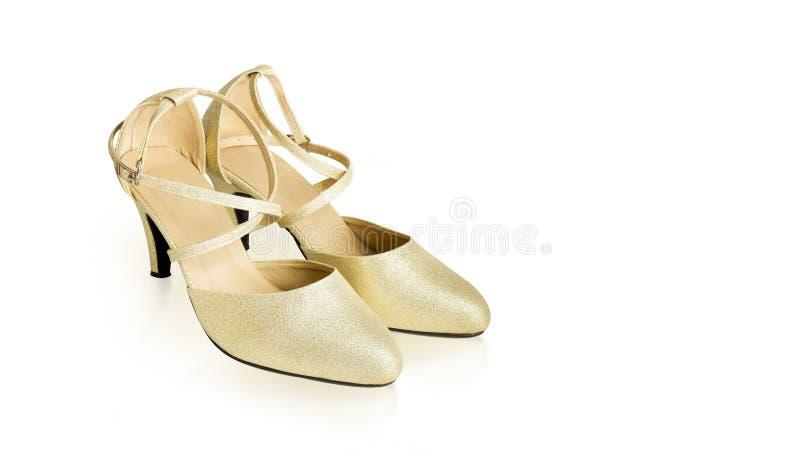金高跟鞋时尚的鞋子妇女 美丽的豪华高跟鞋,侧视图 一个对在发光金黄颜色的高跟鞋 库存图片